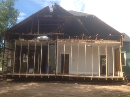 Preparing a larger house to move requires cutting it in half, blocking is needed to secure the walls at the cut
